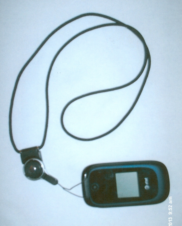 Lanyard attached to closed clamshell cell phone