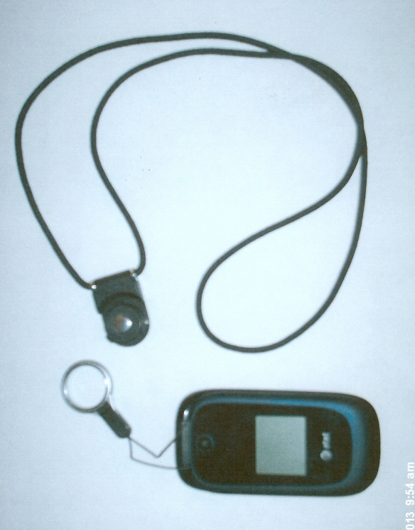 Cell phone detached from pendant-style lanyard